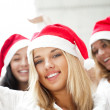 Group of three happy pretty girls are celebrating christmas and — Foto de Stock