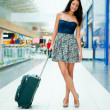Young woman with luggage at the international airport. She is ve — Stock Photo