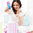 Portrait of young beautiful awake woman with gifts surrounding h — Stock Photo #7289332