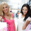 Royalty-Free Stock Photo: Closeup of two attractive happy girls out shopping