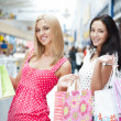 Closeup of two attractive happy girls out shopping — Stock Photo #7289396