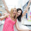 Stock Photo: Closeup of two attractive happy girls out shopping