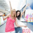 Closeup of two attractive happy girls out shopping — Stock Photo #7289399