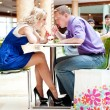 Stock Photo: Closeup portrait of young cute couple at mall cafe.