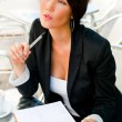 Stock Photo: Business woman working with documents while having lunch or brea