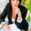 Business woman working with documents while having lunch or brea — Stock Photo