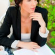 Stock Photo: Portrait of a young attractive business woman sitting at outdoor