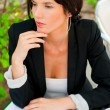 Portrait of a young attractive business woman sitting at outdoor — Stock Photo