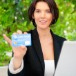 Stock Photo: Business woman making payments online using laptop and credit ca