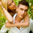 Young couple playing around in the nature - front view. Against — Stock Photo