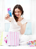 Portrait of young beautiful awake woman with gifts surrounding h — Stock Photo