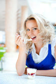 Young woman enjoying coffee time at mall cafe. Eating ice cream dessert — Stock Photo
