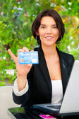 Business woman making payments online using laptop and credit ca — Stock Photo