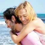 Couple in love - Hispanic man having his caucasian woman piggyba — Stock Photo