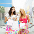 Closeup of two attractive happy girls out shopping. They are mov — Stock Photo
