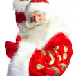 Santa Claus pointing his hand isolated over white. — Stock Photo #7309761