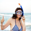 Young hispanic woman with wet skin and with a snorkel standing o — Stock Photo