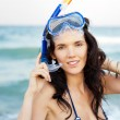 Young hispanic woman with wet skin and with a snorkel standing o - Stok fotoğraf