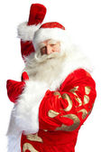 Santa Claus pointing his hand isolated over white. — Stock fotografie