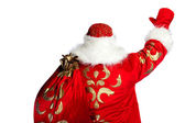 Santa Claus pointing his hand isolated over white. Photo from be — Stockfoto