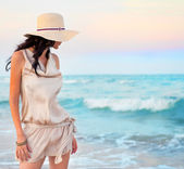 Young beautiful sexy tanned brunette woman wearing straw hat and — Stock Photo