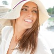 Portrait of pretty cheerful woman wearing white dress and straw — Stock Photo