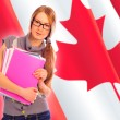 Portrait of pretty young woman holding book in her arms. Canadia — Stock Photo