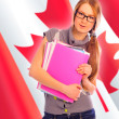 Portrait of pretty young woman holding book in her arms. Canadia — Stock Photo #7557918