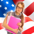 Portrait of pretty young woman holding book in her arms. USA Fla - Stock Photo