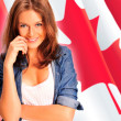 Portrait of a pretty young woman against a Canadian flag , smili — Stock Photo #7557946