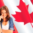 Portrait of a pretty young woman against a Canadian flag , smili — Stock Photo #7557947