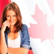 Portrait of a pretty young woman against a Canadian flag , smili — Stock Photo #7557957