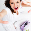 Portrait of young beautiful awake woman with gifts on bed at bed — Stock Photo #7558069