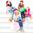 Group of three happy pretty girls are celebrating christmas and new year ho — Stock Photo