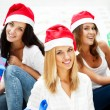 Group of three happy pretty girls are celebrating christmas and new year ho — Stock Photo #7558120