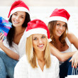Stock Photo: Group of three happy pretty girls are celebrating christmas and new year ho