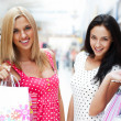 Closeup of two attractive happy girls out shopping — Stockfoto