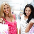Closeup of two attractive happy girls out shopping — Foto de Stock