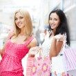 Closeup of two attractive happy girls out shopping — Stock Photo #7558143