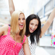 Closeup of two attractive happy girls out shopping — Stock Photo #7558145