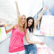 Closeup of two attractive happy girls out shopping — Stock Photo