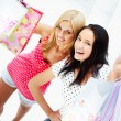 Group of beautiful shopping women with bags and smiling — Stock Photo #7558156