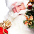 Christmas theme: Santa Claus holding christmas tree and his bag full of gif — Stock Photo #7558205