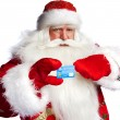 Traditional Santa Claus holding and sowing credit card while giv — Stock Photo