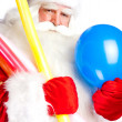 Traditional Santa Claus holding balloons for children. Isolated — Stock Photo #7558335