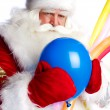 Traditional Santa Claus holding balloons for children. Isolated — Stock Photo #7558336