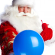 Traditional Santa Claus holding balloons for children. Isolated — Stock Photo #7558340