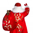 Royalty-Free Stock Photo: Santa Claus standing up on white background with his bag full of