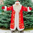 Full Length Portrait of Santa Claus standing with open hands out - Stock Photo