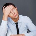 Closeup of a young business man having a stress. Headache. Again — Stock Photo
